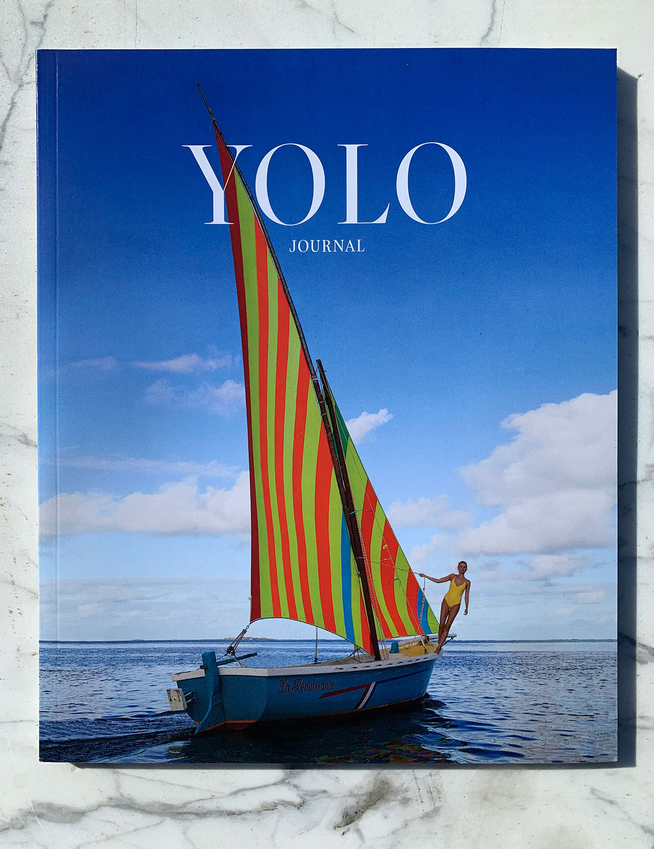 The Winter/Spring 2020 cover of YOLO Journal, featuring the Founder & Creative Director of Alicia Swim, Alicia Rountree in Mauritius. Photo by Dewey Nicks.