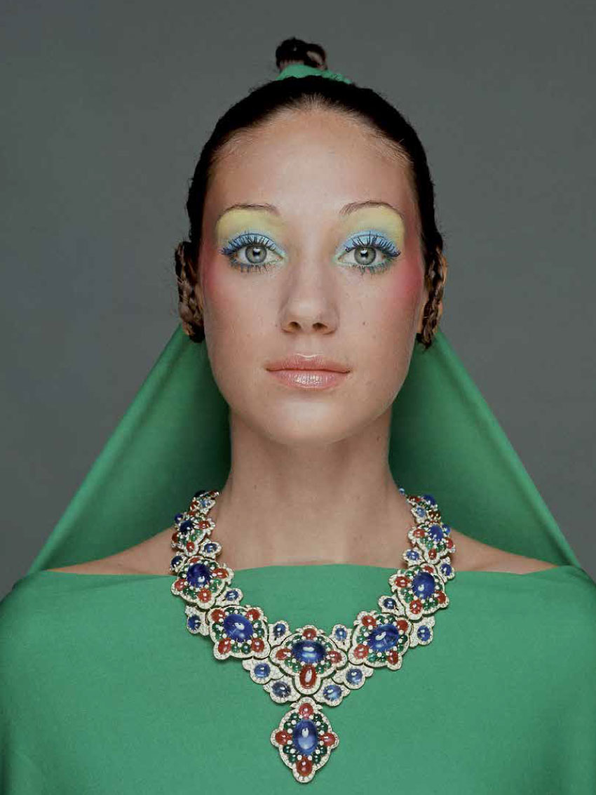 Vogue 1970 Model, Marisa Berenson wearing a green drape and matching hair veil tied from her topknot hairstyle, with a necklace of gold, diamonds, rubies and emeralds by Bulgari; make-up by Alexandre de Markoff.
